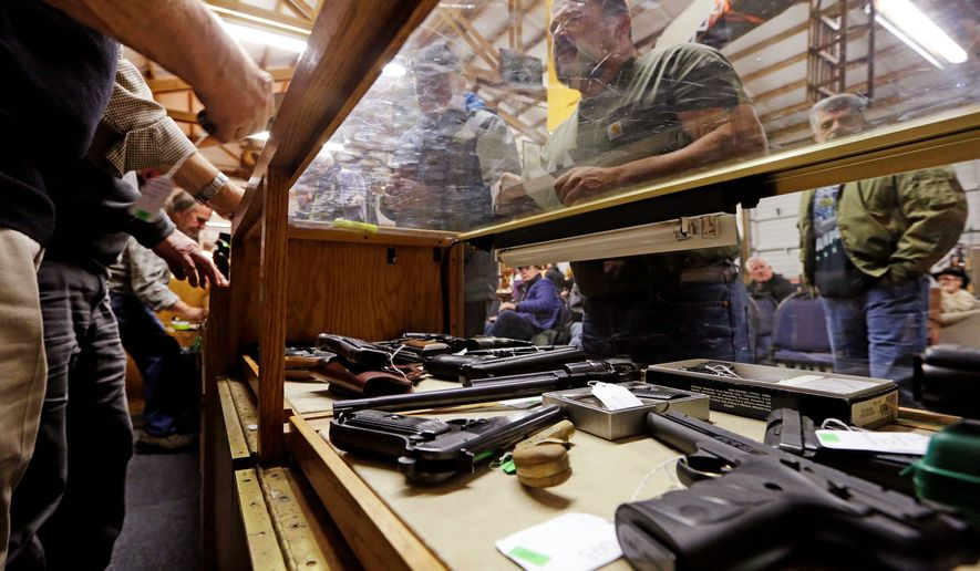 The FBI ran slightly more than 2 million federal gun background checks last month, compared to more than 2.3 million in February 2018. (Associated Press)