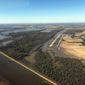 Backwater flooding begins to encircle the Yazoo City, Miss., airport., Sunday, March 17, 2019, as seen in this aerial photograph. Various communities in the Mississippi Delta are combatting both Mississippi River flooding and backwater flooding that are affecting homes, businesses and farm lands. (AP Photo/Holbrook Mohr)
