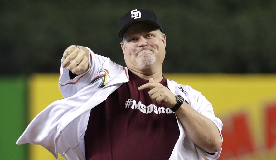Ty Thompson, the principal of Marjory Stoneman Douglas High School, throws a ceremonial first pitch before a baseball game between the Miami Marlins and the Pittsburgh Pirates, Sunday, April 15, 2018, in Miami. (AP Photo/Lynne Sladky)