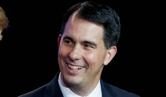 Wisconsin Gov. Scott Walker attends an event to make remarks at a Foxconn facility in Mt. Pleasant, Wis. (AP Photo/Evan Vucci, File)