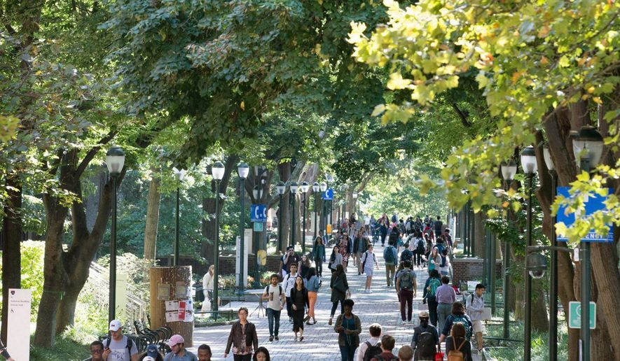 In this September 2017 photo, students walk to class on the University of Pennsylvania campus in Philadelphia. As academia becomes increasingly competitive in attracting top students and staff, universities are turning to retail to create study, work, and play environments that set themselves apart.   (Jessica Griffin/The Philadelphia Inquirer via AP)