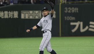 Seattle Mariners right fielder Ichiro Suzuki waves to spectators while leaving the field for defensive substitution in the eighth inning of Game 2 of the Major League baseball opening series against the Oakland Athletics at Tokyo Dome in Tokyo, Thursday, March 21, 2019. (AP Photo/Koji Sasahara) ** FILE **