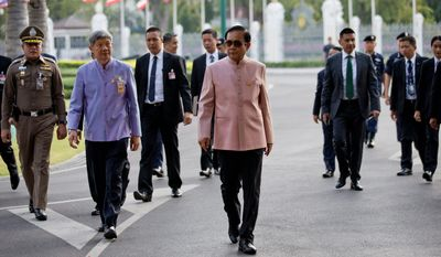 In this Tuesday, March 5, 2019, Thai Prime Minister Prayuth Chan-ocha arrives at the Government House before a cabinet meeting in Bangkok, Thailand. Prayuth became prime minister in a very Thai way: He led a military coup. Now after five years of running Thailand with absolute power, he's seeking to hold on to the top job through the ballot box. (AP Photo/Sakchai Lalit)