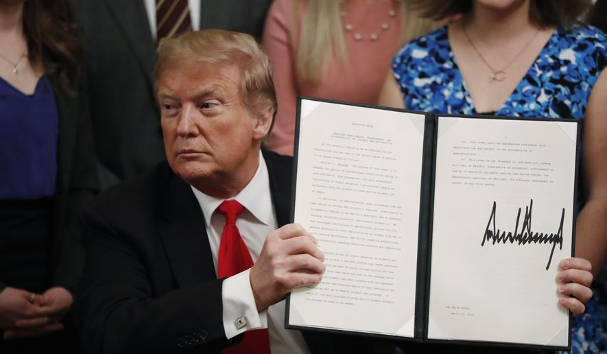 507e34952 President Donald Trump holds up an executive order requiring colleges to  certify that their policies support