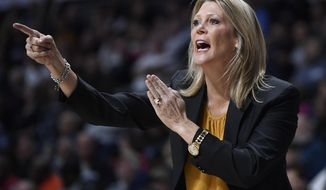 Central Florida head coach Katie Abrahamson-Henderson calls out to her team during the first half of an NCAA college basketball game in the American Athletic Conference women's tournament finals against Connecticut, Monday, March 11, 2019, at Mohegan Sun Arena in Uncasville, Conn. (AP Photo/Jessica Hill)