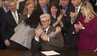 Miss. Gov. Phil Bryant hugs Miss. Sen. Angela Hill-R, Thursday, March 21, 2019 in Jackson after Bryant signed into law what is commonly known as the Heartbeat Bill in Mississippi. The new legislation bans abortion procedures in Mississippi following the detection of a fetal heartbeat. The new legislation is one of the most strict in the United States. Jackson, Miss.   (Sarah Warnock/The Clarion-Ledger via AP)