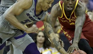 Kansas State's Barry Brown Jr. (5) and Iowa State's Cameron Lard (2) chase a loose ball during the second half of an NCAA college basketball game in the Big 12 men's tournament Friday, March 15, 2019, in Kansas City, Mo. Iowa State won 63-59. (AP Photo/Charlie Riedel)