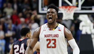 Maryland 's Bruno Fernando (23) celebrates during the final moments of the second half of a first round men's college basketball game against Belmont in the NCAA Tournament in Jacksonville, Fla., Thursday, March 21, 2019. (AP Photo/John Raoux) ** FILE **