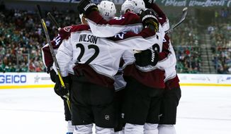 Colorado Avalanche's Colin Wilson (22) and Carl Soderberg (34) celebrate with teammates after defenseman Erik Johnson scoresd a goal during the second period of the team's NHL hockey game against the Dallas Stars in Dallas, Thursday, March 21, 2019. (AP Photo/Sam Hodde)