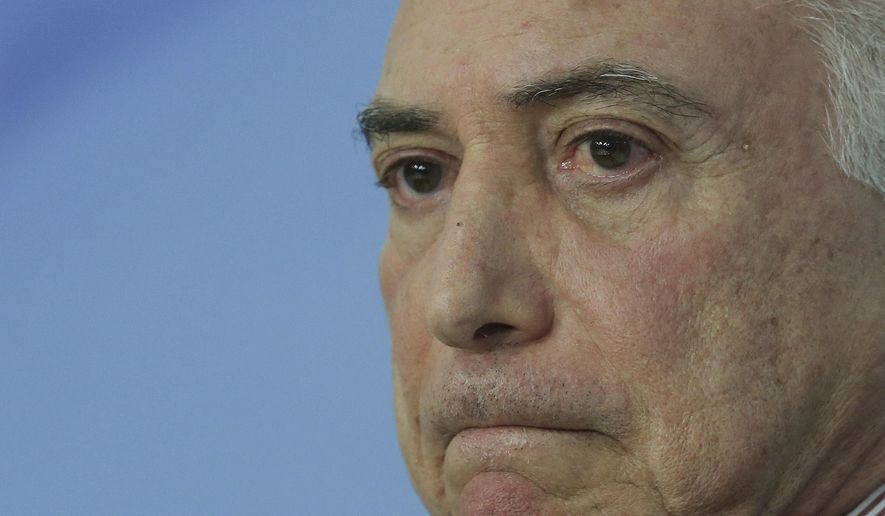 FILE - In this June 1, 2018 file photo, Brazil's President Michel Temer pauses during a speech at the Planalto Presidential Palace, in Brasilia, Brazil. A judge in Rio de Janeiro issued an arrest warrant Thursday, March 21, 2019, for the former president, who is being investigated in several corruption cases. (AP Photo/Eraldo Peres, File)