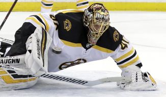 Boston Bruins goaltender Tuukka Rask, of Finland, watches the puck during the second period of the team's NHL hockey game against the New Hersey Devils on Thursday, March 21, 2019, in Newark, N.J. (AP Photo/Julio Cortez)