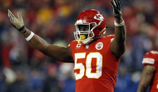 FILE - In this Jan. 12, 2019, file photo, Kansas City Chiefs linebacker Justin Houston (50) celebrates during the second half of an NFL divisional football playoff game against the Indianapolis Colts in Kansas City, Mo. The Indianapolis Colts have signed free agent defensive end Justin Houston. Terms of the deal were not immediately available. (AP Photo/Charlie Neibergall, File)