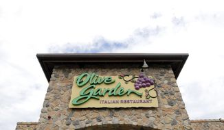 FILE - This June 27, 2016, file photo shows an Olive Garden restaurant in Methuen, Mass. Darden Restaurants Inc. reports earnings Thursday, March 21, 2019. (AP Photo/Elise Amendola, File)