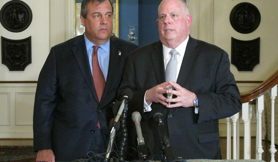 """Maryland Gov. Larry Hogan, right, talks to reporters with former New Jersey Gov. Chris Christie, left, on Thursday, March 21, 2019 at the governor's residence in Annapolis, Md. Hogan, who still isn't entirely ruling out a potential primary challenge to President Donald Trump because it's unclear what the future holds, said that currently """"it doesn't make any sense at all."""" Christie says he doesn't see a political path at the moment for challenging Trump, because of the president's approval ratings among Republicans. (AP Photo/Brian Witte)"""