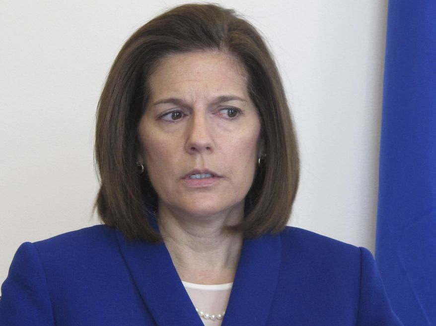 FILE - In this Jan. 11, 2019 file photo, Sen. Catherine Cortez Masto, D-Nev., talks to reporters in her office in Reno, Nev. Sen. Catherine Cortez Masto says Energy Secretary Rick Perry has committed to expediting the removal of weapons-grade plutonium it secretly shipped to a site in Nevada last year if she agrees to stop blocking appointments to vacant positions in his department. (AP Photo/Scott Sonner, File)
