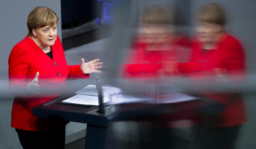 German Chancellor Angela Merkel delivers a speech about the Brexit ahead of a meeting of the European council, at the German parliament Bundestag in Berlin, Germany, Thursday, March 21, 2019. (AP Photo/Markus Schreiber)