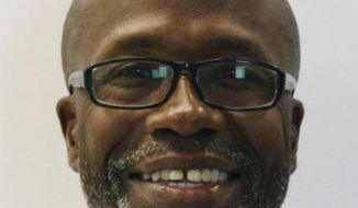 Keith Smith is shown in an undated photo provided by the Baltimore Police Department. On March 3, 2019 the Baltimore Smith a truck driver who blamed his wife's slaying on a case of charity gone wrong was being flown back to Maryland's biggest city on Wednesday, March 20, 2019 along with his daughter to face murder charges in a case that drew international attention. (Baltimore Police Department via AP)