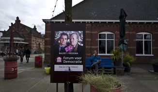-FILE- In this Sunday, March 5, 2017 photo, a damaged election poster showing, left, Thierry Baudet and Theo Hiddema, from the Forum for Democracy party, FVD, is displayed in a park in Amsterdam, Netherlands. The Netherlands woke up to the stentorian sound of a new populist star on Thursday. Right-wing lawmaker Thierry Baudet surged into the Dutch political mainstream as the biggest winner in nationwide elections that determine the makeup of the parliament's upper house and also impacts the coalition government of Prime Minister Mark Rutte.(AP Photo/Muhammed Muheisen)