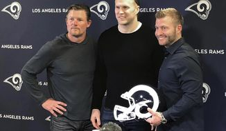 Los Angeles Rams linebacker Clay Matthews, center, stands with general manager Les Snead, left, and coach Sean McVay at the NLF football team's training complex in Thousand Oaks, Calif., Thursday, March 21, 2019. Matthews agreed to a two-year contract to return to his native Southern California with the Rams after playing for a decade with the Green Bay Packers. (AP Photo/Greg Beacham)