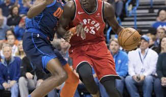 Toronto Raptors forward Pascal Siakam (43) drives to the basket past Oklahoma City Thunder forward Jerami Grant (9) during the first half of an NBA basketball game Wednesday, March 20, 2019, in Oklahoma City. (AP Photo/Rob Ferguson)