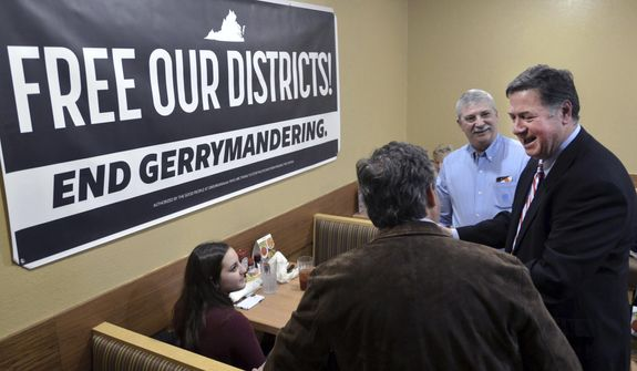 In this Feb. 2, 2019, photo, former Virginia Gov. and U.S. Sen. George Allen (right) talks with supporters during a stop in Bristol, Va. Allen was on a five-city town hall tour of Virginia to discuss the need for nonpartisan and transparent redistricting reform during this year's General Assembly session. In Vermont, a commission submits plans for state House and Senate districts to the state Legislature, which can approve or change them. (David Crigger/Bristol Herald Courier via AP) **FILE**