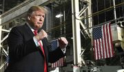 President Donald Trump make two fists while making his entrance to the Joint Systems Manufacturing Center to address employee's.  (Craig J. Orosz /The Lima News via AP)