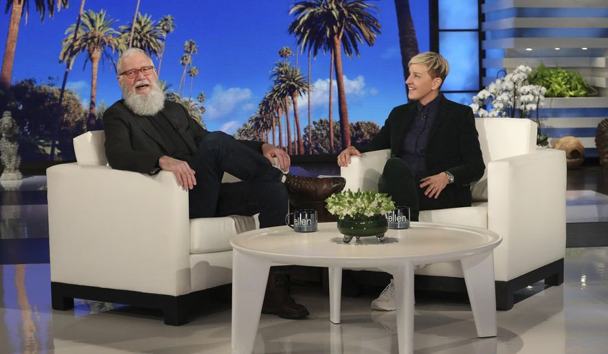 """In this March 7, 2019 photo released by Warner Bros., David Letterman appears with host Ellen DeGeneres during a taping of """"The Ellen DeGeneres Show"""" in Los Angeles. Letterman said he stuck around on network television about 10 years too long. He made that revelation during an appearance airing Thursday on DeGeneres' talk show. Letterman quit in 2015 after 33 years as a late-night host on CBS and NBC, and is beginning his second season on his more leisurely-paced Netflix show. (Michael Rozman/Warner Bros. via AP)"""