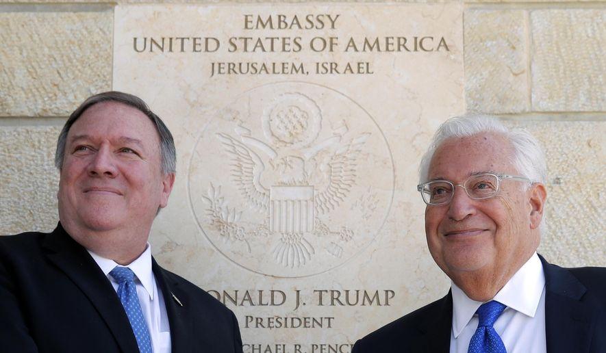 Secretary of State Mike Pompeo (left) visited U.S. Ambassador to Israel David M. Friedman last month at the U.S. Embassy in Jerusalem. (Associated Press/File)