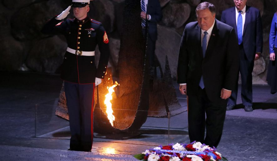 U.S. Secretary of State Mike Pompeo takes part in a wreath-laying ceremony commemorating the six million Jews killed by the Nazis in the Holocaust, in the Hall of Remembrance at Yad Vashem World Holocaust Remembrance Center in Jerusalem, Wednesday, March 21, 2019. (Jim Young/Pool Image via AP)