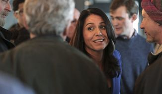 Presidential hopeful U.S. Rep. Tulsi Gabbard, D-Hawaii, greets guests during a gathering at a campaign stop at a brewery in Peterborough, N.H., Friday, March 22, 2019. (AP Photo/Charles Krupa)