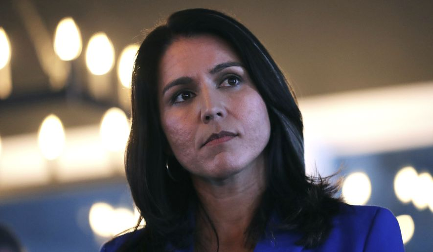 Presidential hopeful U.S. Rep. Tulsi Gabbard, D-Hawaii, listens to a question during a campaign stop at a brewery in Peterborough, N.H., Friday, March 22, 2019. (AP Photo/Charles Krupa) ** FILE **