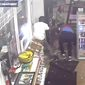 Footage released by the Huntsville Police Department shows a gas station clerk fending off two knife-wielding suspects during an attempted robbery, March 16, 2019. The Alabama man defended himself with a machete. (Image: Huntsville Police Department)