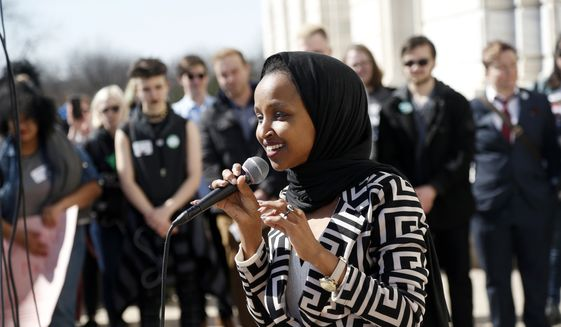 In this file photo, U.S. Rep Ilhan Omar, D-Minn., speaks to a rally of high school students from across the state of Minnesota outside the State Capitol steps in St. Paul on Thursday, March 21, 2019. (AP Photo/Jim Mone) ** FILE **