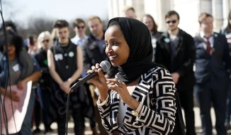 """U.S. Rep Ilhan Omar, D-Minn., speaks to support LGBTQ and allied high school students from across the state of Minnesota who marched to the State Capitol steps Thursday, March 21, 2019 in St. Paul, Minn. to urge lawmakers to protect LGBTQ Minnesotans and youth from the effects of so-called conversion """"therapy."""" (AP Photo/Jim Mone)"""