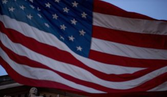 An American flag flies outside the Department of Justice in Washington, Friday, March 22, 2019. (AP Photo/Andrew Harnik) ** FILE **