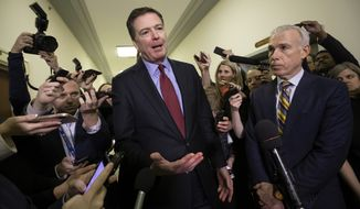 In this Dec. 7, 2018, file photo, former FBI Director James Comey, with his attorney, David Kelley, right, speaks to reporters after a day of testimony before the House Judiciary and Oversight committees, on Capitol Hill in Washington. (AP Photo/J. Scott Applewhite, File) **FILE**