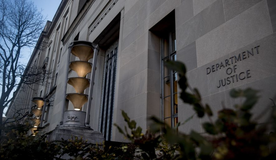 The Department of Justice in Washington, Friday, March 22, 2019, as Special counsel Robert Mueller has concluded his investigation into Russian election interference and possible coordination with associates of President Donald Trump. The Justice Department says Mueller delivered his final report Friday to Attorney General William Barr, who is reviewing it. (AP Photo/Andrew Harnik)