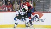 Minnesota Wild defenseman Jonas Brodin (25), of Sweden, checks Washington Capitals left wing Jakub Vrana (13), of the Czech Republic, into the boards during the third period of an NHL hockey game Friday, March 22, 2019, in Washington. The Wild won 2-1. (AP Photo/Nick Wass) ** FILE **