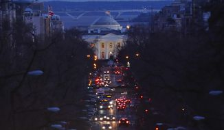 The American flag flies over the White House as vehicles move along 16th Street, in northwest Washington, Friday, March 22, 2019. (AP Photo/Pablo Martinez Monsivais) ** FILE **