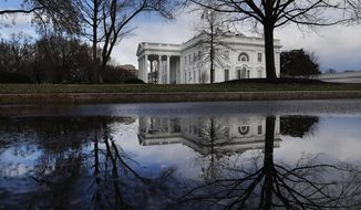 The White House is reflected in a puddle, Friday March 22, 2019, in Washington, as news breaks that the special counsel Robert Mueller has concluded his investigation into Russian election interference and possible coordination with associates of President Donald Trump. The Justice Department says Mueller delivered his final report Friday to Attorney General William Barr, who is reviewing it. Mueller's report, still confidential, sets the stage for big public fights to come. The next steps are up to Trump's attorney general, to Congress and, in all likelihood, federal courts. (AP Photo/Jacquelyn Martin)