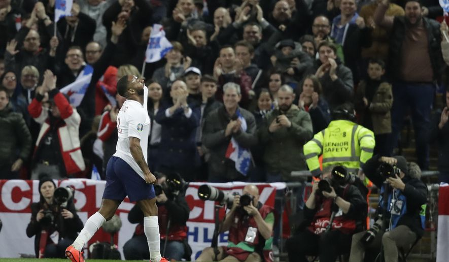 England's Raheem Sterling celebrates his sides third goal during the Euro 2020 group a qualifying soccer match between England and the Czech Republic at Wembley stadium in London, Friday March 22, 2019. (AP Photo/Matt Dunham)
