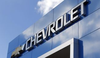 FILE - This April 26, 2017 file photo shows a Chevrolet sign at a Chevrolet dealership in Richmond, Va. Less than a week after a series of critical tweets from President Donald Trump over an Ohio plant closure, General Motors is announcing plans to add 400 jobs and build a new electric vehicle at a Michigan factory. The company said Friday, March 22, 2019,  it will spend $300 million in Orion Township to build a Chevrolet vehicle based on the battery-powered Bolt. (AP Photo/Steve Helber, File)