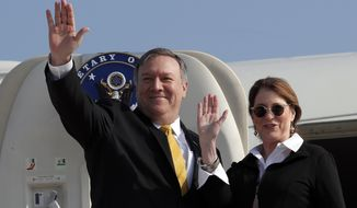 U.S. Secretary of State Mike Pompeo and his wife Susan wave before boarding their airplane to Beirut at Ben Gurion airport near Lod, Israel, Friday, March 22, 2019. (Jim Young/Pool Photo via AP)