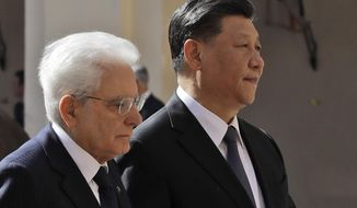 "Chinese President Xi Jinping, right, and Italian President Sergio Mattarella review the honor guard at the Quirinale Presidential Palace, in Rome, Friday, March 22, 2019. Jinping is launching a two-day official visit aimed at deepening economic and cultural ties with Italy through an ambitious infrastructure building program called ""Belt and Road"" that has raised suspicions among Italy's U.S. and European allies. (AP Photo/Alessandra Tarantino)"