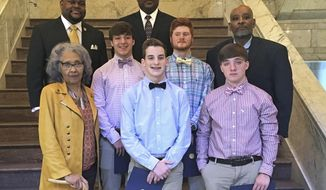 In this March 21, 2019, photograph state lawmakers honor four teenagers who helped rescue a 2-year-old girl from her mother's car as it was sinking into a creek on March 9, 2019, in Leland, Miss., following an appearance before both chambers of the Legislature at the Capitol in Jackson. On the front row are Rep. Alyce Clarke, D-Jackson, left; Austin McNemar, 15, and Seth Humphrey, 17. On the middle row are Jacob Humphrey, 17 and C.J. Holland, 18, and Rep. John Hines, D-Greenville. On the back row are Rep. Otis Anthony, D-Indianola and Riverside High School principal Donald Coleman. All four of the teenagers attend Riverside High School. (AP Photo / Emily Wagster Pettus)