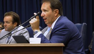 FILE - In this Aug. 16, 2018 file photo, Attorney General Jeff Landry speaks during a Bond Commission hearing, in Baton Rouge, La. Gov. John Bel Edwards' budget proposal for next year violates the Louisiana Constitution, Republican Attorney General Landry said in a legal opinion issued Friday, March 22, 2019, that marks his latest dust-up with the Democratic governor. (AP Photo/Melinda Deslatte, File)