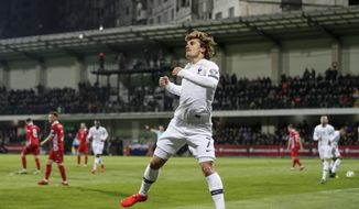 France's Antoine Griezmann celebrates after a goal during the Euro 2020 group H qualifying soccer match between Moldova and France at Zimbru stadium in Chisinau, Moldova, Friday, March 22, 2019. (AP Photo/ Roveliu Buga)