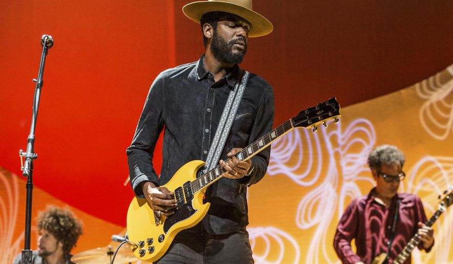 "FILE - This Nov. 5, 2017 file photo shows Gary Clark Jr. performing at the Summit LA17 in Los Angeles. Clark confronts racism with his new album ""This Land.""    (Photo by Amy Harris/Invision/AP, File)"