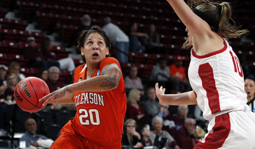 Clemson guard Simone Westbrook (20) looks for a layup shot while defended by South Dakota guard Allison Arens (10) during a first round women's college basketball game in the NCAA Tournament in Starkville, Miss., Friday, March 22, 2019. (AP Photo/Rogelio V. Solis)