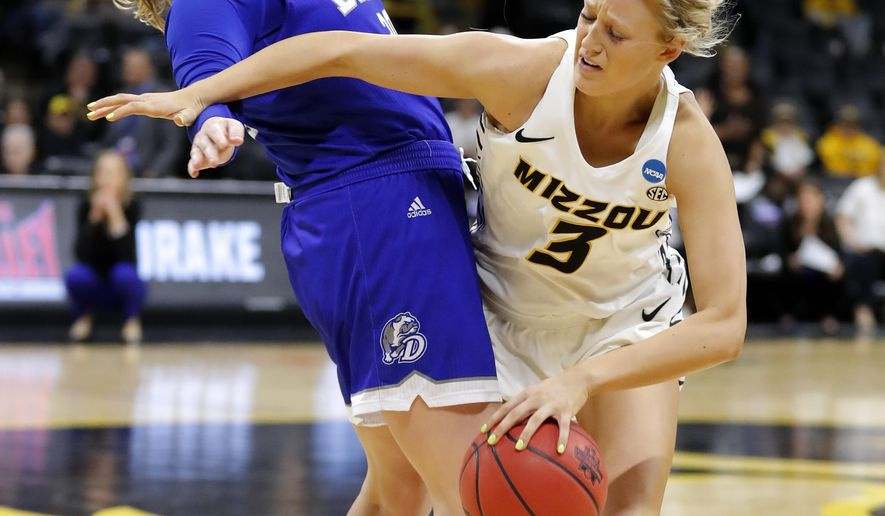 Missouri guard Sophie Cunningham, right, is fouled by Drake guard Maddy Dean during a first-round women's college basketball game in the NCAA Tournament, Friday, March 22, 2019, in Iowa City, Iowa. (AP Photo/Charlie Neibergall)
